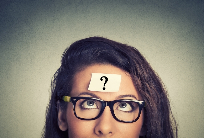 thinking woman with question mark